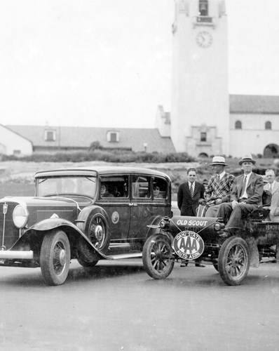 Black and white photograph of men and cars by Boise Train Depot circa 1930s or 40s