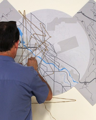 Person working on large map
