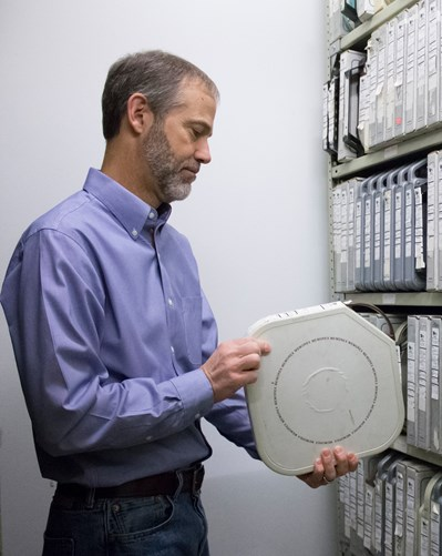 Person holding archival film